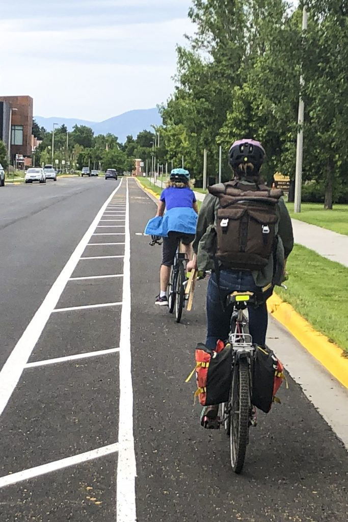 Two bicycle riders use newly marked bike lane.