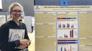 Student presents poster at university research event